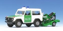 Mercedes Benz 300 GE Polizei mit Motorrad